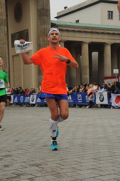 Awkward pose for getting Berlin Marathon finisher pix